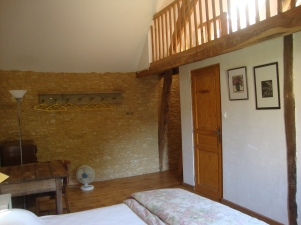 The mezzanine level in the second double bedroom is reached by a ladder.