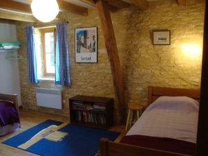 With two single beds, the middle bedroom overlooks the courtyard.