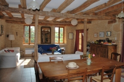 Original beams add character to the spacious, open-plan kitchen, dining and lounge area. The dining table seats eight comfortably. There is high chair for our younger guests.