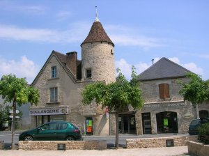The St Ju boulangerie and boucherie sit side by side opposite the church in the village