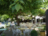 The shaded dining terrace at Le Pont de l'Ouysse, Lacave, about 27 km from La Vieille Grange.